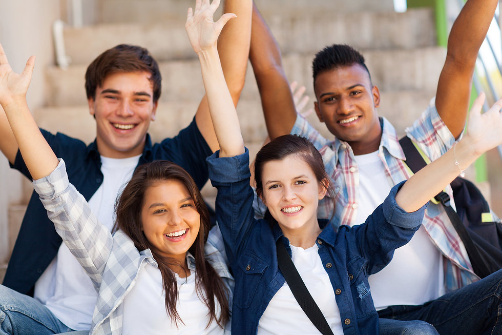 excited high school students with arms o