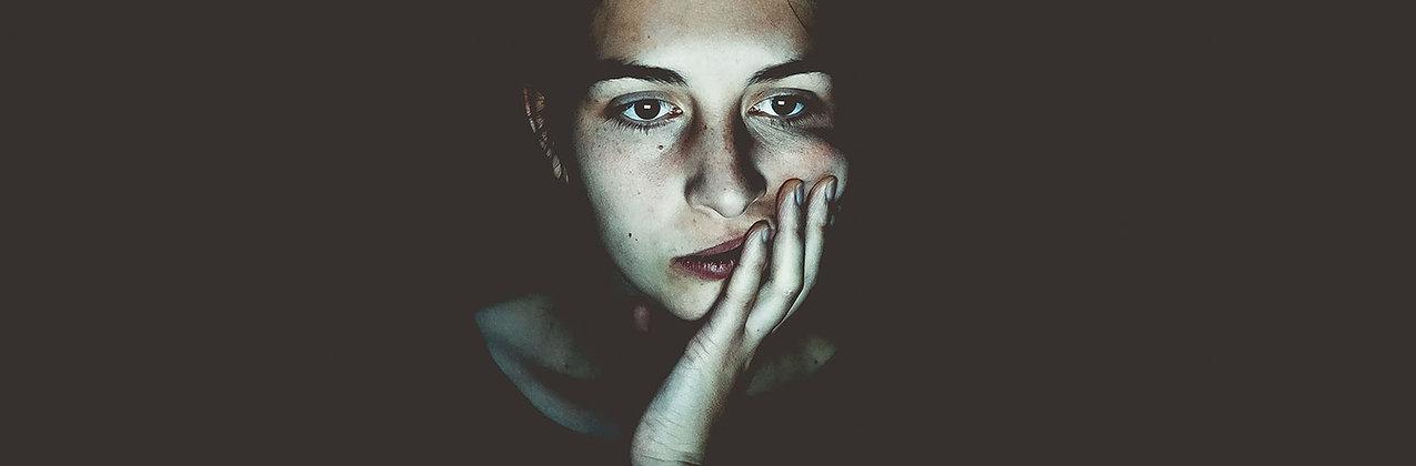 Woman sitting in the dark