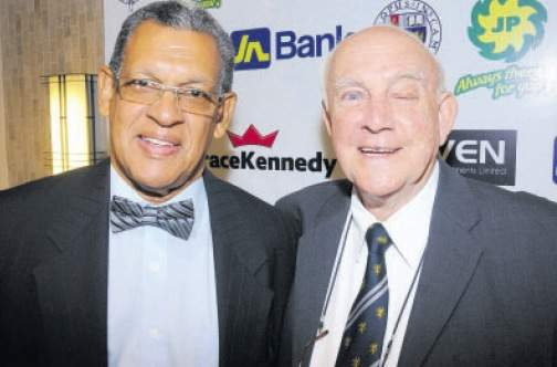 Professor Renn Holness (left) and Ainsley Henriques share lens time last Wednesday at the 26th Annual Carlton Alexander Awards hosted by the Jamaica College Old Boys Association at the Jamaica Pegasus Hotel in Kingston.