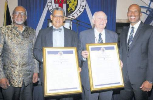 (From left), Judge Patrick Lipton Robinson, Jamaican member of the International Court of Justice and former President of the International Criminal Tribunal for Yugoslavia; 2017 Carlton Alexander Awardees Professor Renn Holness, Ainsley Henriques; and Jamaica College Old Boys Association president Major Basil Jarrett pause for a photo opportunity following the night's festivities. (Photos: Joseph Wellington)