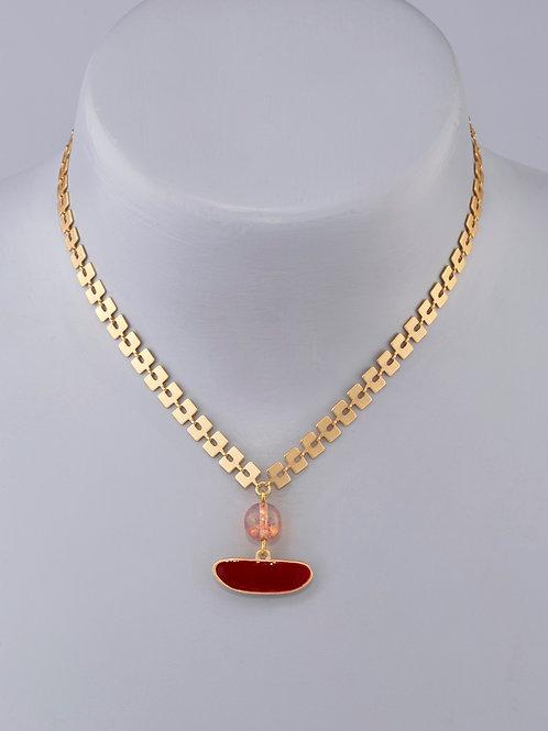 Galet rouge perlé