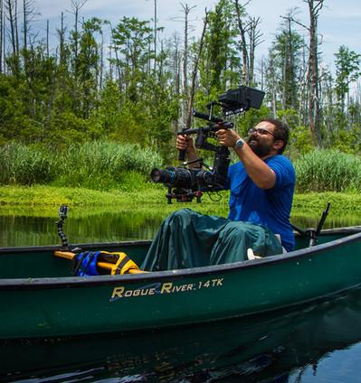 Roshan Patel filming in the field in North Carolina.