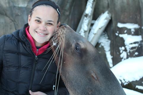 Juliana Kim with a sea lion.