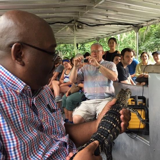 Duane Hills educates visitors about an alligator.