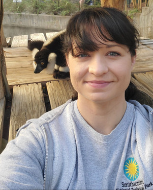Carly Hornberger with a black-and-white ruffed lemur.