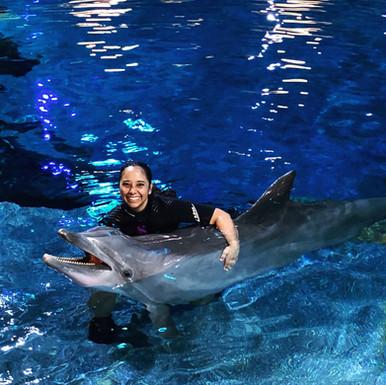 Meagan Minadie with dolphin Calvin.