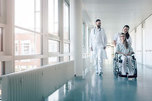 Doctor, nurse, and patient in wheelchair