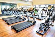 Set of treadmills staying in line in the