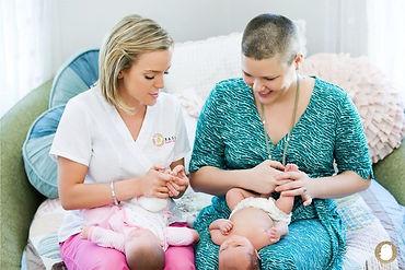 Christine Duarte, postpartum doula, offers baby massge techniques