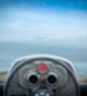 Binocular next to the waterside promenad