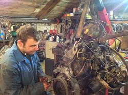 Liam Hammond working on an engine