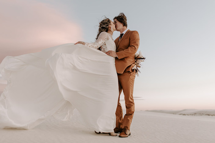 Sarah wearing our Whiskey gown, a lace long sleeve A-line dress with a high neckline, unlined sleeves and an open back.