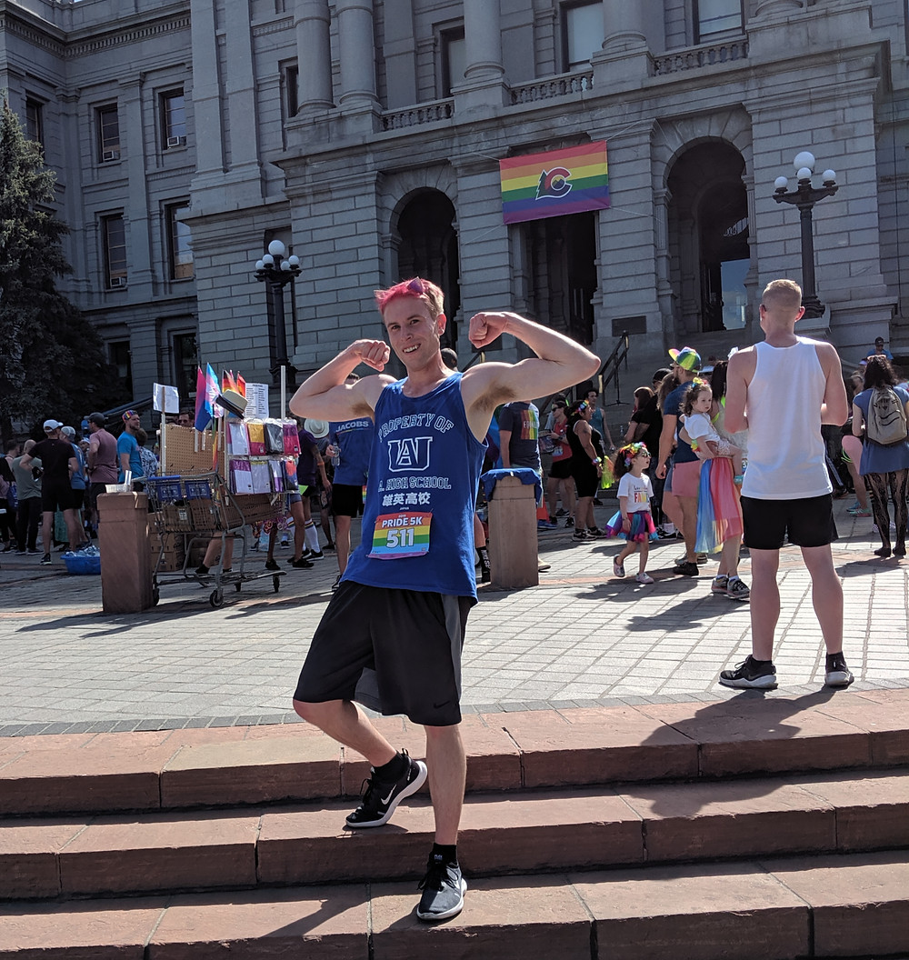 John Knetemann in front of Denver's capital building at the Pride 5K run
