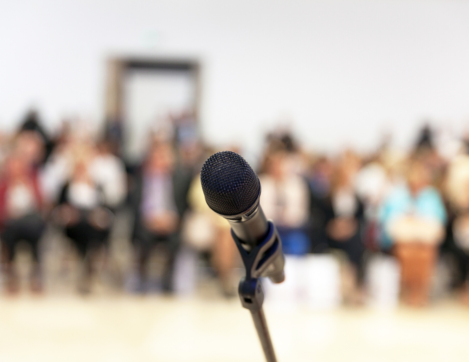 microphone in front of an audience