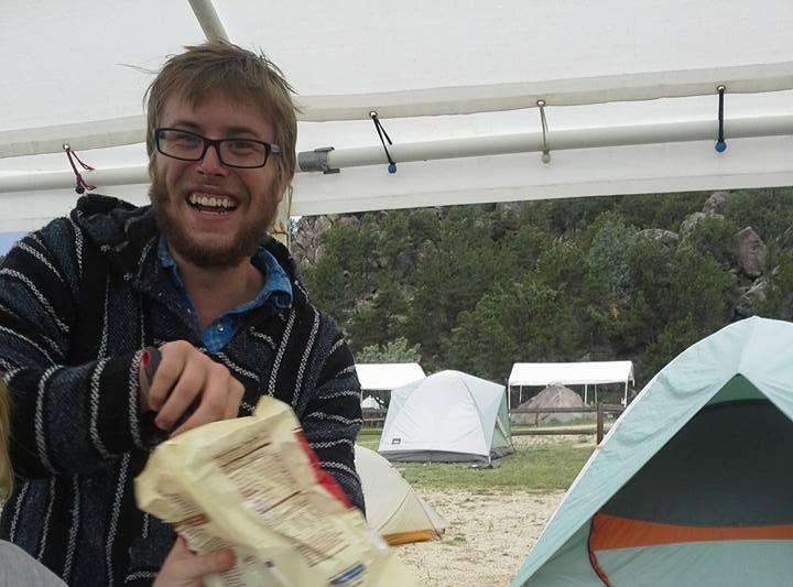 John Knetemann serving food as a camp counselor