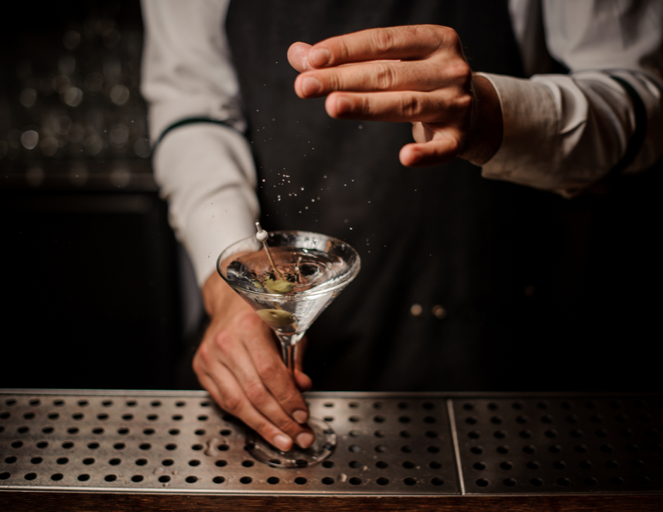 A bartender preparing a martini