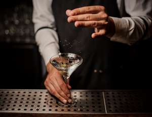 A bartender preparing a martini