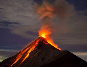 a volcano that looks like mount doom from Lord of the Rings erupting