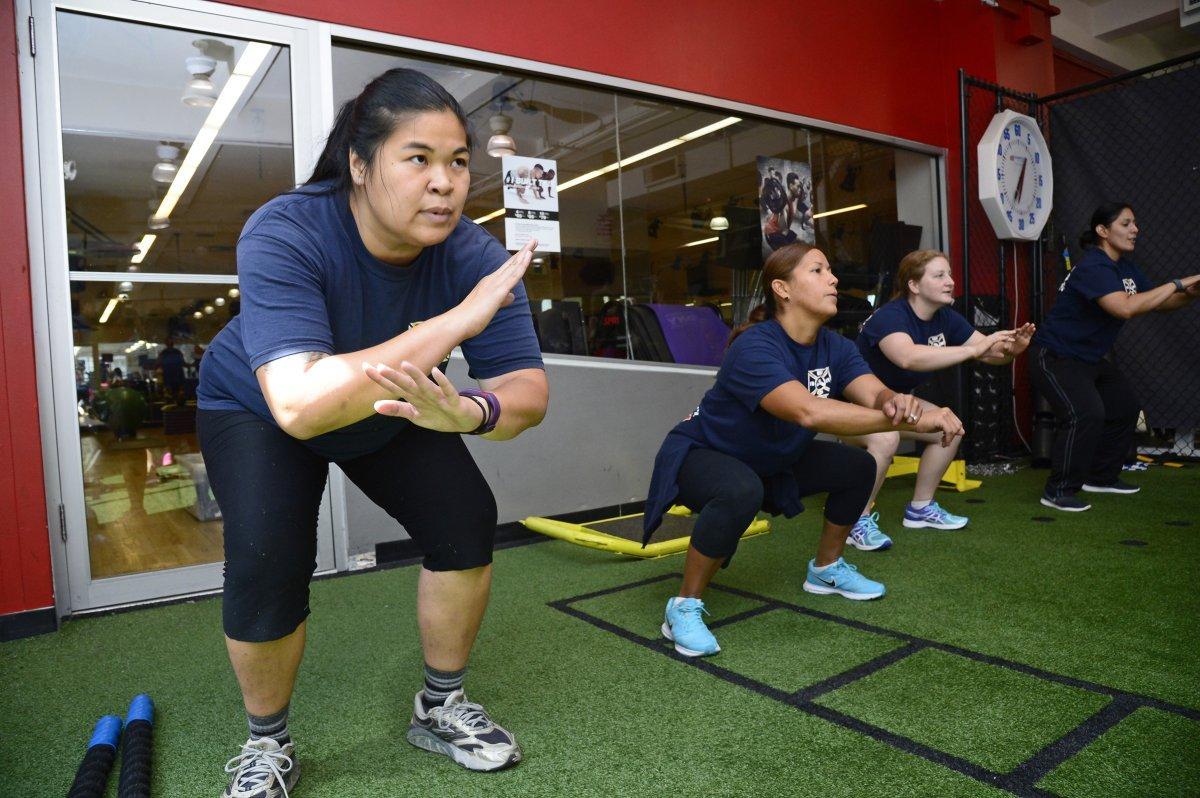 Female aspiring firefighters prepare