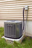 a-residential-central-air-conditioning-unit-sitting-outside-a-home_SYD4KL0rs.jpg