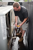 a-young-hvac-technician-working-on-a-commercial-air-system-on-the-rooftop_rF_oVuRHo.jpg