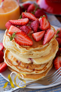 Vanilla pancakes with strawberry salad of passion