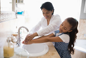grandmother-and-granddaughter-washing-ha
