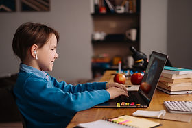 online-learning-boy-using-laptop-for-his