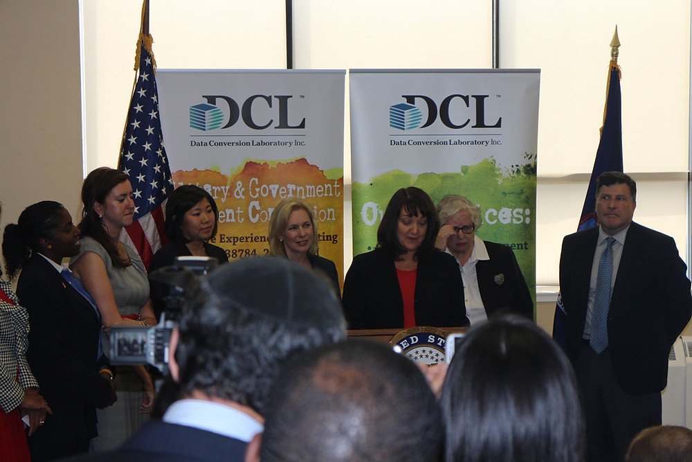 Amy Williams, COO at Data Conversion Laboratory speaks at a press conference to expand access and oppportunities for women-owned small business. Amy presented along with Senator Kirsten Gillibrand and Congresswoman Grace Meng.