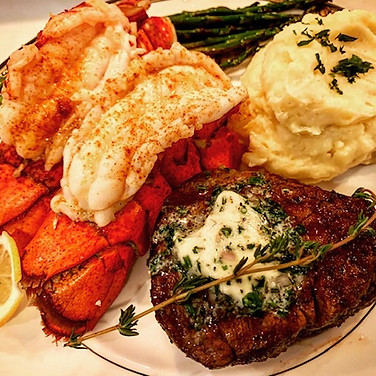Lobster Tail & Filet Mignon with Compond Herb Butter.