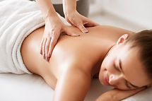 Young girl receiving back massage with c