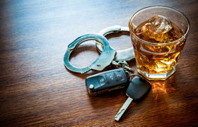 whiskey, hadcuffs, and car keys, drunk driving