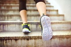 graphicstock-female-runner-running-up-th