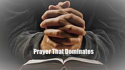 Praying man hand and bible on desk.jpg