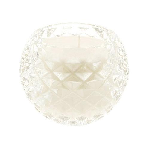 Bougie coulée dans un verre transparent