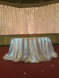 Silver Sequin Draped Table