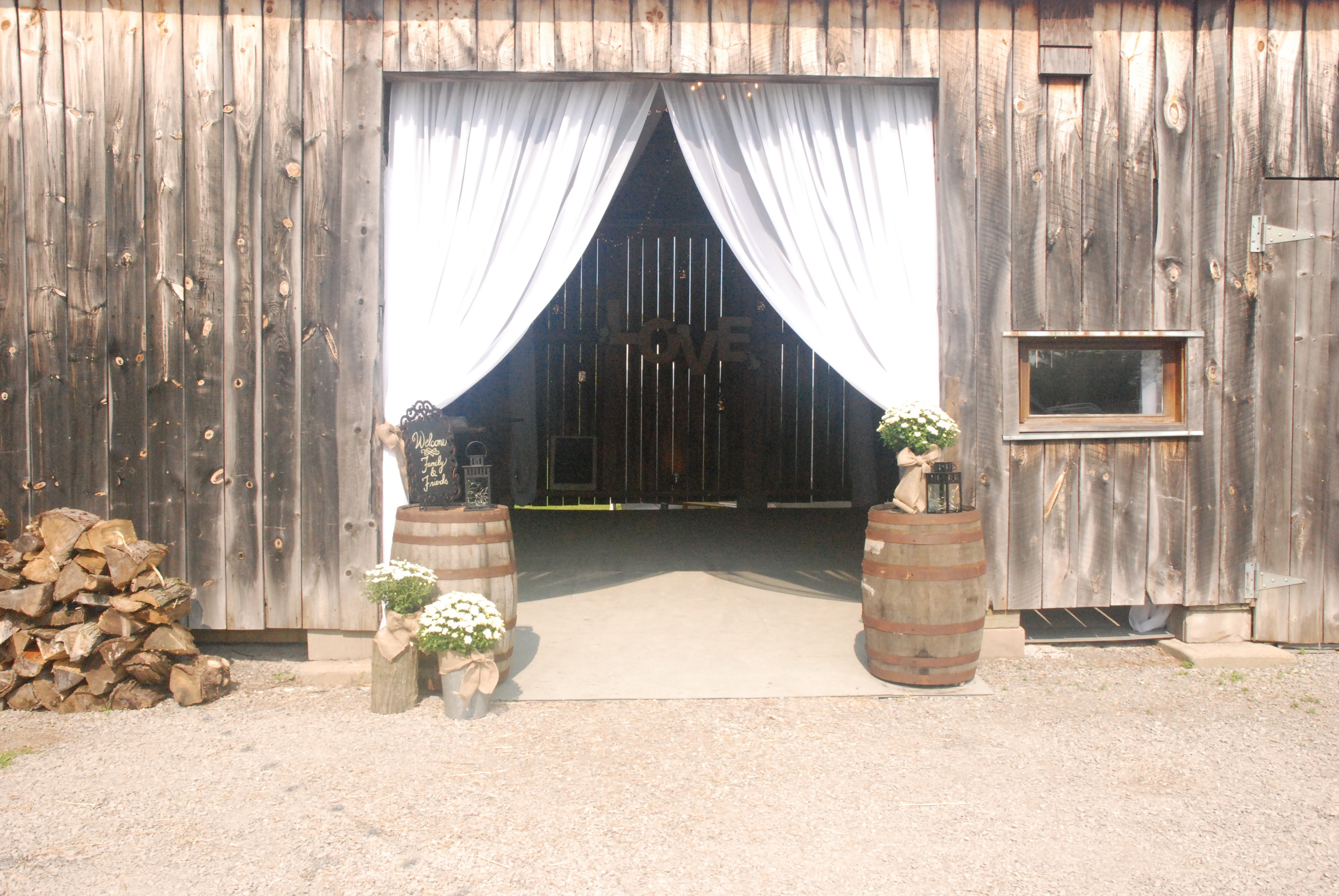 Barn Entrance Draping with Whiskey Barrels