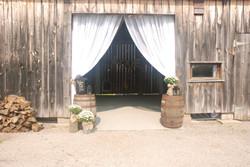 Barn Entrance Draping with Whiskey Barrels
