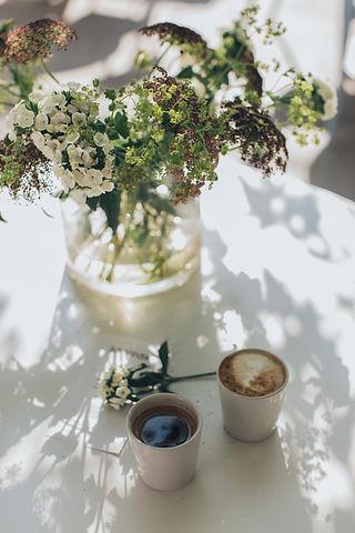photo-of-coffee-beside-vase-3099635.jpg
