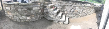Yorkshire stone wall with concrete retaining wall behind