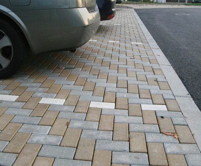 Blockpaving to allow for water draing off of the Asphalt road way