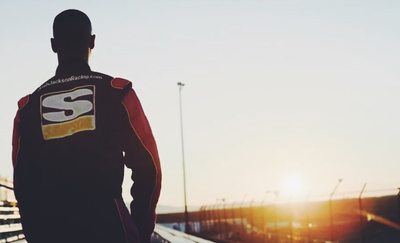 Joshua Jackson looks over the race track in A Prayer for Joshua Jackson