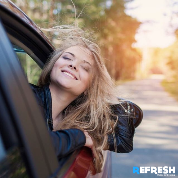 Girl enjoying car breeze