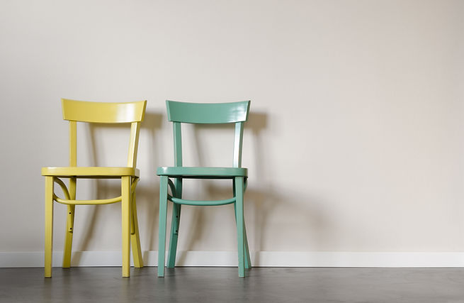 Two chairs in a waiting room in front o