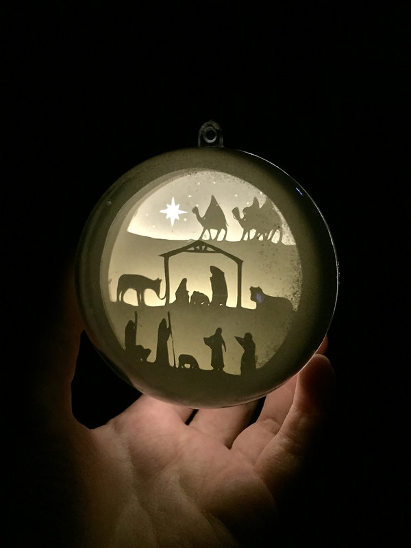 Christmas ball with light and papercut design