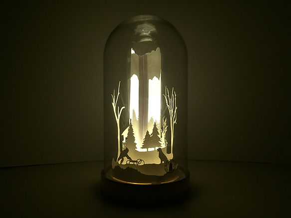 papercut shadow box in a glass dome