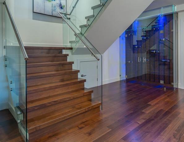 Caspio Glass Staircase Railing & Wine Cellar