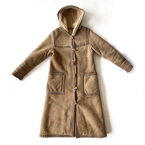Manteau long en peau retournée