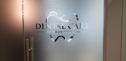 A dental office with their frosted glass logo displayed at entrance. Great commercial use for decora