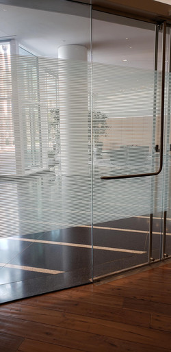 Thin lines decorative film pattern shown at entrance of building. Frosted film can come in many diff